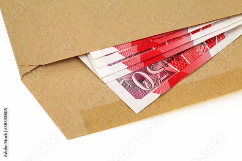 isolated envelope with 50 pound notes