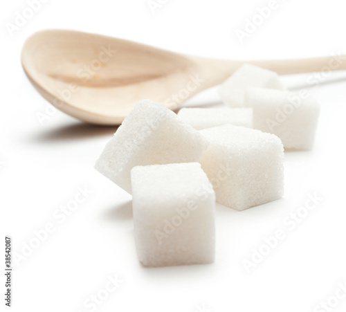 Cubes of sugar with wooden spoon