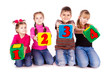 Happy kids holding blocks with numbers
