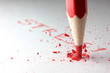 Smashed red pencil
