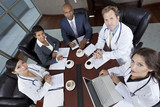 Interracial Medical Business Team Meeting in Boardroom