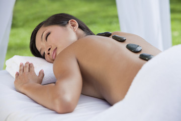 Woman Relaxing Health Spa Hot Stone Treatment Massage