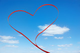 Red ribbon in heart shape poster