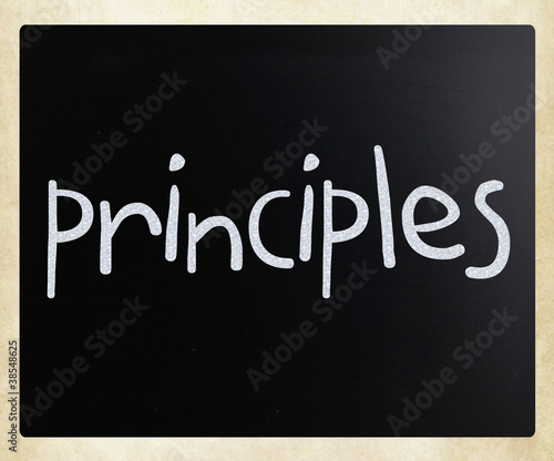"""Principles"" handwritten with white chalk on a blackboard"