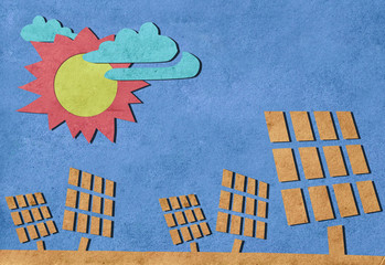 Solar cells station recycled paper craft stick on paper backgrou