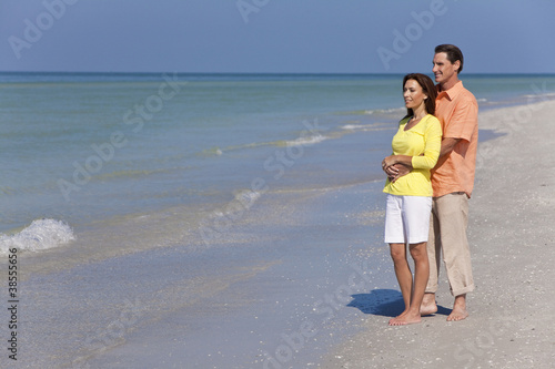 Happy, Man and Woman Couple Embracing on An Empty Beach