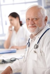 Portrait of senior doctor smiling