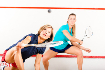 Squash racket sport in gym court, women competition