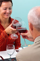 Mature couple toasting with red wine