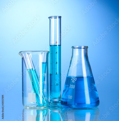 Laboratory glassware with blue liquid with reflection