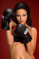 Sexy woman wearing boxing glowes
