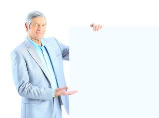 Portrait of senior businessman with blank board