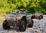 ATV's parked on the shore of a mountain river. - 38562287