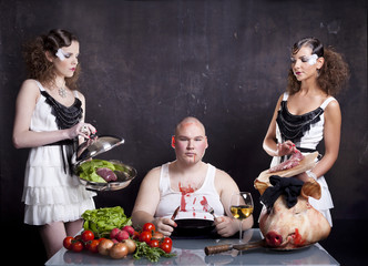 Young girls serving raw pig heart to a fat man