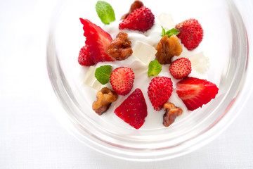 Yogurt with strawberries and nuts