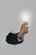 Businessman holding a light bulb