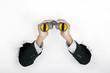Businessman holding a binoculars