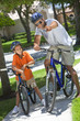 African American Man & Boy, Father and Son Riding Bikes