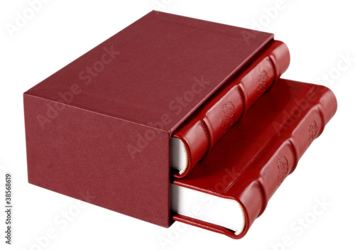 Red leather diaries in a hard cover box