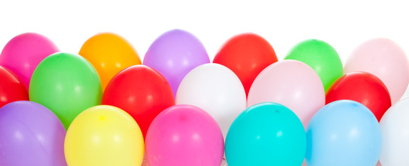 colorful balloons on floor over white background