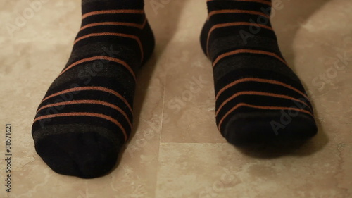 Man legs in brown strip socks
