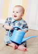 little boy with a watering can
