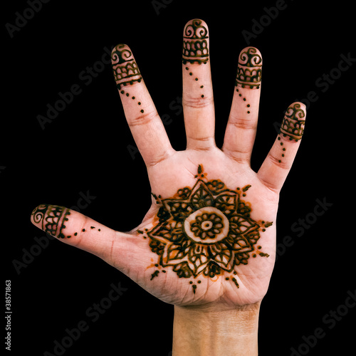 Henna design on the palm of the hand - isolated in black