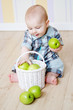 little boy with a basket of apples