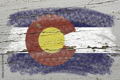 flag of US state of colorado on grunge wooden texture precise pa