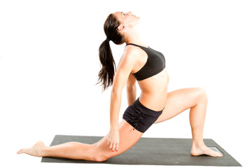 woman in sports bra on yoga pose on isolated