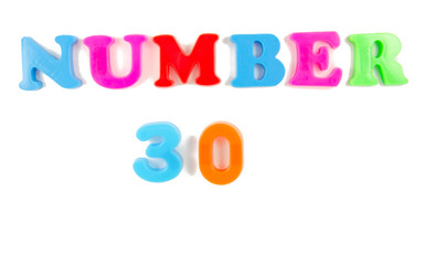 number 30 written in fridge magnets
