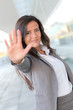 Businesswoman showing hand towards camera