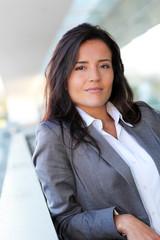 Portrait of beautiful businesswoman standing outside