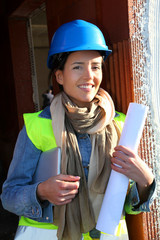 Woman architect standing on construction site
