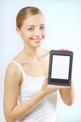 Attractive girl with the e-book reader