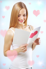 smiling girl with valentine card
