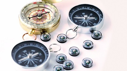 Nine small compasses, two big and one vintage golden