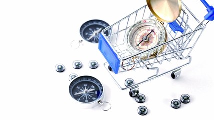 compasses lie near little shopping cart