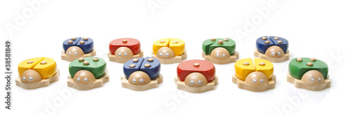 wooden bugs toys on white background