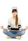 Fototapety Woman balancing books on head