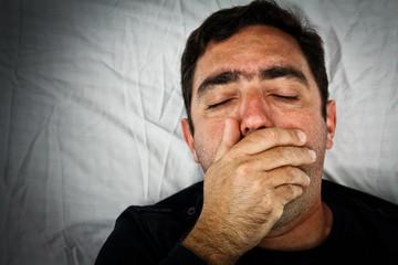 Grunge portrait of a very sick hispanic man