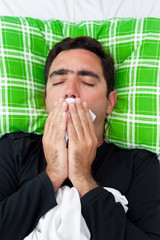 Sick man trying to avoid coughing or vomiting