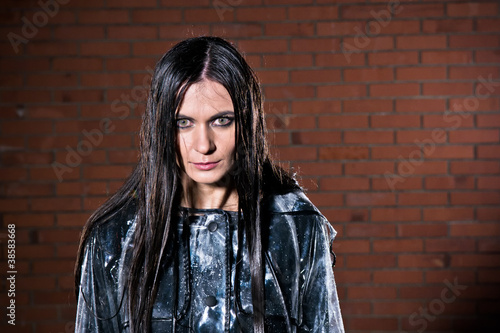 Angry woman with wet hair after the rain