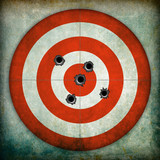 Target with bullet holes, grunge background