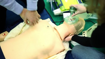 Person trains to do chest  artificial ventilation