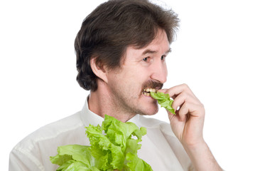 Man eats sheet of the salad