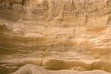 Geological layers of earth in deep sand pit poster