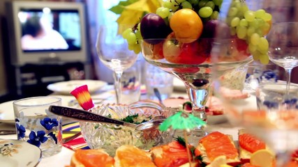 Bowl of fruit and different snacks on the table