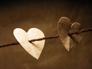 Two paper hearts tied on wire. Love concept.