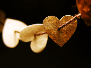 Paper hearts tied on wire. Love concept.